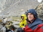 Chris and Dave waiting out the storm at the lower saddle. The Exum guide huts are in the background.