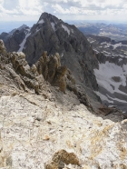 Looking down the descent gully, Middle Teton in the background.